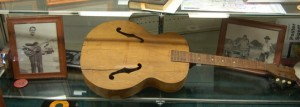 Waylon Jennings' first guitar, and picture of him playing it