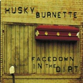 husky-burnette-facedown-in-the-dirt