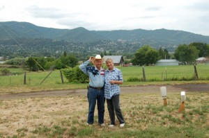 Don & Barbara on the Revolution Ranch w/ Ashland, OR in the background