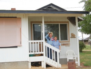 "Don and ""child bride"" Barbara on their ranch house porch"