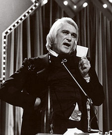 "Charlie Rich ""Burns"" John Denver at the 1975 CMA Awards"