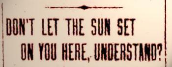 sundown-town-sign