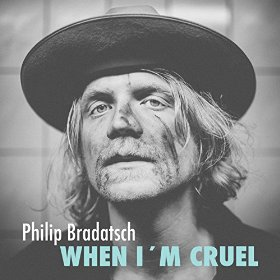 "Dinosaur Truckers' Philip Bradatsch Goes Solo with ""When I'm Cruel"" (review)"