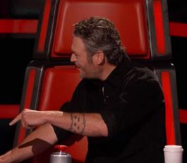 Blake Shelton arguing with Adam Levine