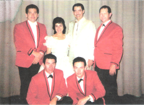 Eddie Pleasant on the far right with Wilma Lee and Stoney Cooper.