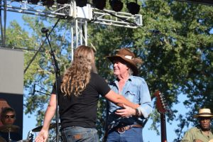 Billy Joe Shaver and Jamey Johnson embrace after a duet