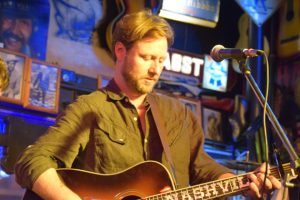"""Cory Branan is best known for his own songwriting, but took the stage to play """"How I Got To Memphis"""" and """"Behind Closed Doors"""" with the Robert's house band."""